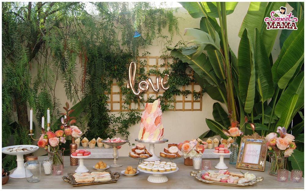 Mesa dulce para bodas con detalles en color coral, color tendencia 2019
